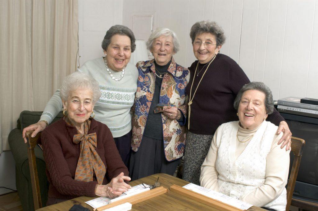 Orchard Ridge Residences   Senior women smiling and playing word game