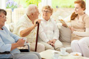 Orchard Ridge Residences | Group of seniors with caregiver