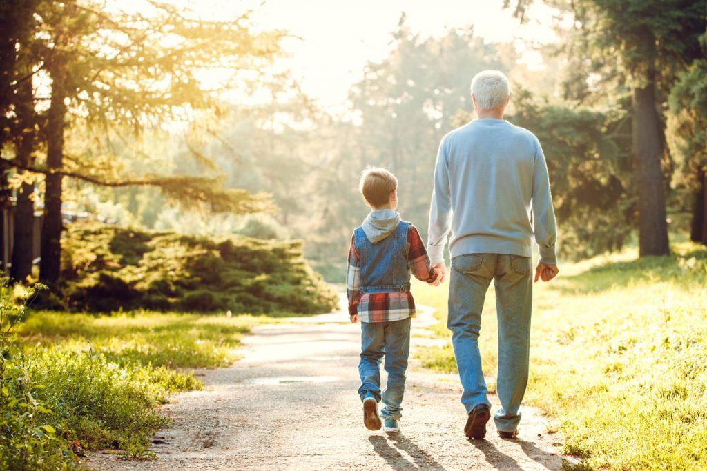 Orchard Ridge Residences | Senior man running with grandson outdoors