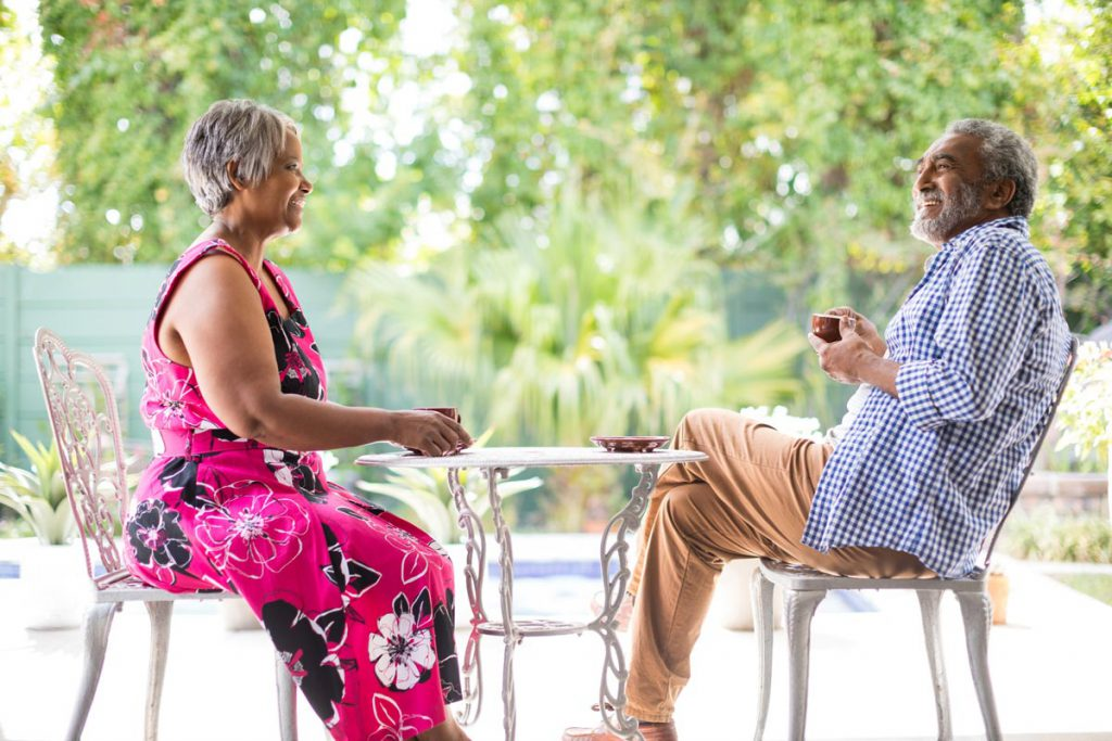 Orchard Ridge Residences   Senior couple at an outdoor table