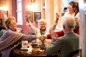 Orchard Ridge Residences | Seniors playing game