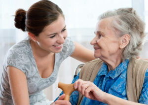 Orchard Ridge Residences | Senior receiving help from caregiver